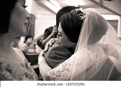 JAKARTA 2017 - Bride is crying while hug her father after blessing ceremony in a church