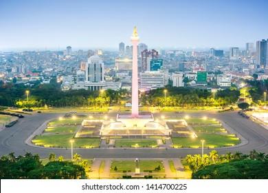 Jakarta city skyline with iconic symbol likes National Monument (Monas) at night. Jakarta, Indonesia