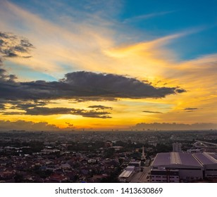 Jakarta cityscape at sunset, with beautiful vibrant colored sky.