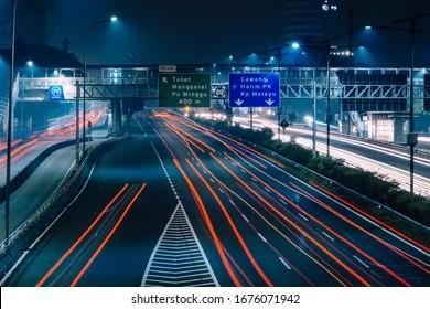 Jakarta, DKI / Indonesia - February 28 2020: Light streaks of cars in jakarta highway at night