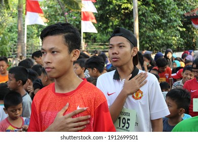 Jakarta, Indonesia - 08 19 2018: man singing the Indonesian national anthem at the opening of the inter-village marathon competition in celebration of Indonesia's 73rd independence day