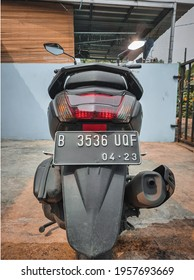 Jakarta, Indonesia - 18 April, 2021: back view motorcycle scooter with back lamp, plat number or another language is plat nomor motor in Indonesian