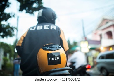 JAKARTA, INDONESIA - 30 JANUARY 2018: An unidentified Uber driver on the streets of Jakarta, Indonesia.