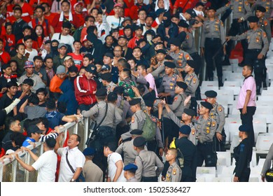 JAKARTA INDONESIA 5 SEPT : Unidentified fans of Indonesia during the FIFA World Cup Qatar and AFC Asian Cup China 2023 Qualification Round 2 at Gelora Bung Karno Stadium