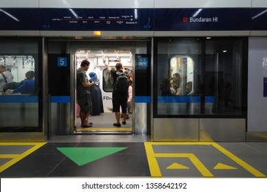 Jakarta, Indonesia - April 03, 2019: Passengers on the train of MRT Jakarta at MRT Station