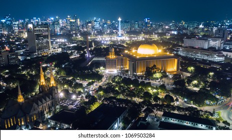 JAKARTA - Indonesia. April 04, 2018: Aerial view of Istiqlal mosque with National Monument (Monas) and Cathedral shot at night on April 04,2018 in Central Jakarta.