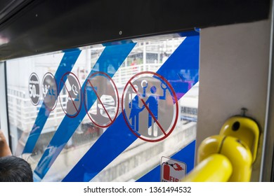 JAKARTA - Indonesia. April 04, 2019: Close up of warning signs in the interior of Transjakarta bus window