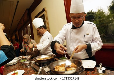 Jakarta / Indonesia - April 1, 2016 : Two professional chef cooking in the restaurant at the Sultan Hotel & Residence Jakarta