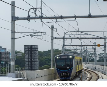 Jakarta, Indonesia - April 17, 2019: MRT Jakarta train arrives at Lebak Bulus MRT Station.