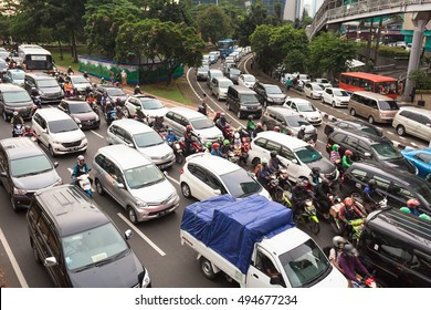 JAKARTA, INDONESIA - APRIL 18, 2016: Many cars and motorcycles are stuck in a traffic jam in a very crowded street in Jakarta, Indonesia capital city.