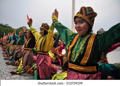 Jakarta, Indonesia - April 19, 2015 : Ratoh Jaroe Saman dancers perform in Jakarta, Indonesia. Saman Dance is a traditional dance of the Province of Nanggroe Aceh Darussalam, Indonesia.