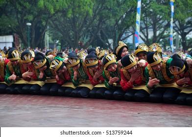 Jakarta, Indonesia - April 19, 2015 : Ratoh Jaroe Saman dancers perform in Jakarta, Indonesia. Saman Dance is a traditional dance of the Province of Nanggroe Aceh Darussalam, Indonesia.