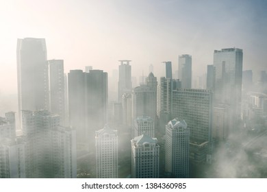 JAKARTA - Indonesia. April 24, 2019: Aerial view of severe air pollution with skyscrapers in Jakarta city