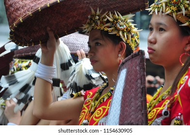 Jakarta, Indonesia - April 28, 2013: Dayak girl from Borneo, Kalimantan are following the Dayak Borneo Festival in Jakarta, the capital city of Indonesia.