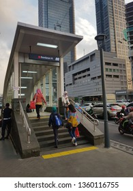 Jakarta, Indonesia - April 5 2019: People entering the new MRT station along Jalan Thamrin in the heart of Jakarta business district. The underground train is in the first line in Indonesia capital.