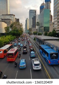 Jakarta, Indonesia - April 5 2019: Traffic jam along the Thamrin avenue in the heart of Jakarta business district in Indonesia capital city. The Transjakarta bus have a separate traffic lane to avoid.