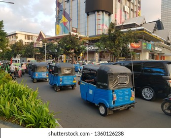 Jakarta, Indonesia - April 5 2019: Auto rickshaw similar to tuk tuk, called Bajaj, in the very crowded streets of Jakarta, Indonesia capital city. This is a traditional transportation option.