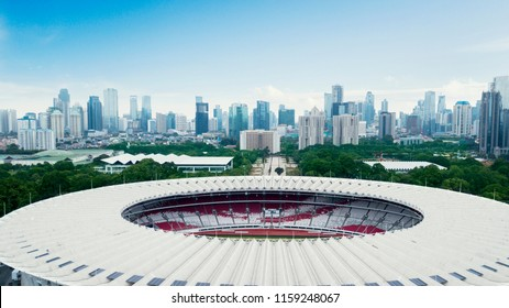 JAKARTA - Indonesia. August 13, 2018: Beautiful scenery of Senayan Stadium under blue sky with Jakarta cityscape background