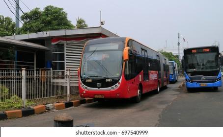 JAKARTA, INDONESIA - August 14, 2017: Transjakarta bus at shelter in Kota Tua