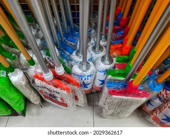 Jakarta, Indonesia, August 14, 2021, various types of floor mops or alat pel lantai are for sale hanging on supermarket shelves or rak pasar swalayan.