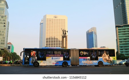 Jakarta, Indonesia - August 15, 2018: Transjakarta bus at Hotel Indonesia roundabout in Central Jakarta.