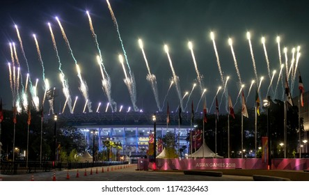 JAKARTA, INDONESIA - AUGUST 18, 2018 :   Fireworks explode over Gelora Bung Karno Main Stadium during the opening ceremony of the 18th Asian Games.