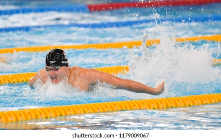 JAKARTA, INDONESIA - AUGUST 18, 2018 : Joseph Isaac Schooling of Singapore winning Men's 50m Butterfly final match on the 18th Asian Games Jakarta at Aquatic Centre Gelora Bung Karno.