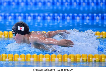 JAKARTA, INDONESIA - AUGUST 18, 2018 : Japan swimmer in action during butterfly event at the GBK Auquatics Center of the 18th Asian Games Jakarta