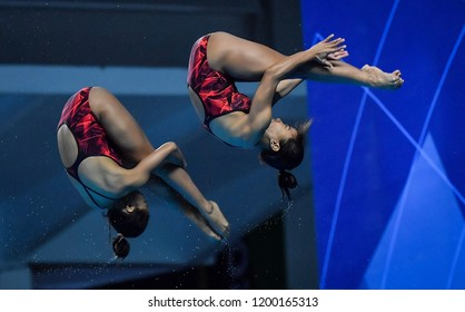 JAKARTA, INDONESIA - AUGUST 18, 2018 : Indonesia diving athlete compete in Women's Synchronised 10m Platform Diving Final on the 2018 Asian Games in Jakarta.