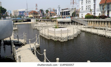 Jakarta, Indonesia - August 2, 2018: Riverbanks of Krukut River along Jl. Kali Besar Timur and Jl. Kali Besar Barat in Old City area turned into a public park.