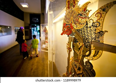 Jakarta, Indonesia (August 2013) : A family visit the Wayang (puppet) Museum in Old City of Jakarta. Visiting museum become a popular activity for tourist.
