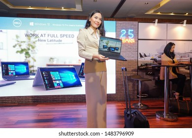 Jakarta, Indonesia - August 21, 2019: Young woman with Dell Latitude 2019 series business laptop.