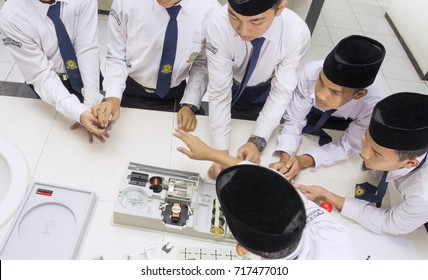 JAKARTA, INDONESIA - AUGUST 26, 2016 :  Muslim students is studying in laboratory