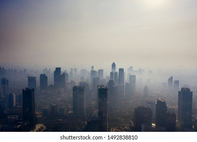 JAKARTA - Indonesia. August 27, 2019: Air pollution scenic with silhouette of skyscrapers at morning time in Jakarta city