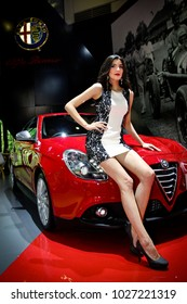 Jakarta, Indonesia, August 29, 2015 : An adult professional model is posing on a Alfa Romeo car at Indonesia International Motor Show 2015 event.