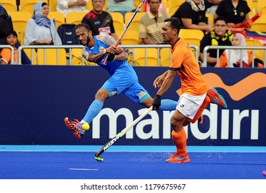 Jakarta, Indonesia - August 30, 2018 : Marhan Jalil (R) of Malaysia and Sunil (L)  of India in action during Asian Games 2018 in GBK Hockey Turf, Jakarta Indonesia