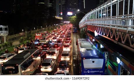 Jakarta, Indonesia - August 31, 2018: Traffic jam in rush hours at Jalan Sudirman at Friday night.