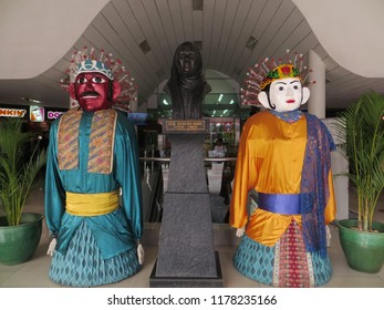 JAKARTA, INDONESIA - August 7, 2018: Statue of HR Rasuna Said between two Ondel-ondel giant puppets at Pasar Festival.