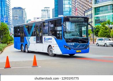 Jakarta / Indonesia - Dec 29, 2018: Indonesian Transjakarta Bus (Public Tranportation Busway) on Sudirman Street