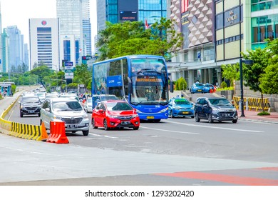 Jakarta / Indonesia - Dec 29, 2018: The Jakarta Explorer bus, TransJakarta city tour bus, Indonesian Double Decker Transjakarta Bus (Public Tranportation Sightseeing Busway) on Sudirman Street