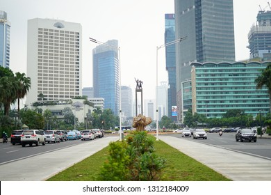 Jakarta, Indonesia - December 1, 2018: Indonesia Capital City Icon. The Selamat Datang Monument is located in the center of a round about known as Bundaran Hotel Indonesia.