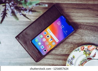 Jakarta, Indonesia - December 13, 2018: The OPPO A3S Android smartphone has a 6.2-inch display with a notch and 88.8 percent screen-to-body ratio.