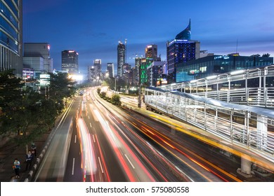 JAKARTA, INDONESIA - DECEMBER 20, 2016: Traffic rushes through Jakarta main avenue in the business district at night in Indonesia capital city.