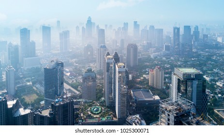 JAKARTA - Indonesia. December 26, 2017: Skyscraper buildings at Jakarta Central Business District in misty morning