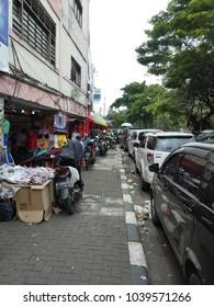 Jakarta, Indonesia; December 28, 2017; small shops on a sidewalk in Glodok (commerce district in Jakarta)