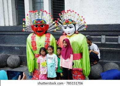 JAKARTA, INDONESIA - December 28, 2017: People Take a Photo with Ondel ondel at Kota Tua Square