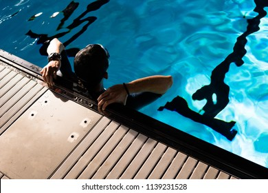 JAKARTA, INDONESIA - DECEMBER 5, 2017: Sandiaga Uno was resting on the side of the pool, which was prepared for the Asian Games event held at the Senayan sports rink, Jakarta.