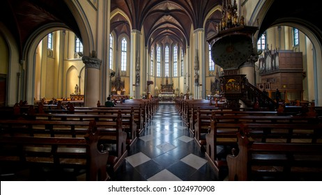 Jakarta, Indonesia. February 09, 2018: Christian tourist praying at Roman Catholic Cathedral