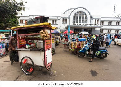 JAKARTA, INDONESIA - FEBRUARY 12, 2017: Street food vendors wait for customers in front of the Jakarta Kota train station in Indonesia capital city old colonial town.