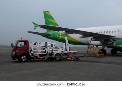Jakarta, Indonesia, February 13rd, 2018: Pertamina car is refueling the Citilink plane at Soekarno Hatta International Airport